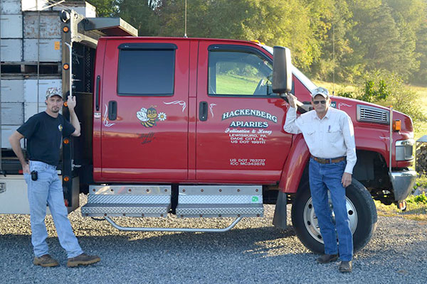 Owners in front of Tractor Trailer
